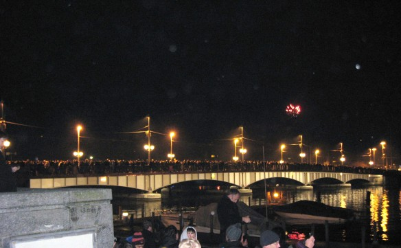Lots of people waiting on the bridge for fireworks!
